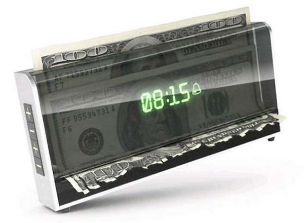 お札を裁断する目覚まし時計
